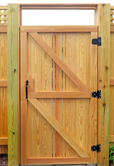 Architectural construction detail. New wood fence gate door.