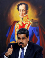 Venezuela's President Nicolas Maduro gestures to the International observers for the upcoming May 20 election at