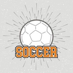 Vintage soccer ball with sunburst on grunge background