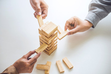Alternative risk plan and strategy in business, Young intelligent business team playing the wood game, hands of executive cooperation placing wood block on the tower, Collaborative management Wall mural