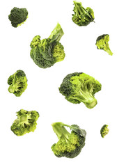 isolated broccoli falling on white background with clipping path