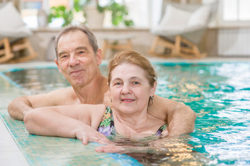 happy elderly couple in the pool