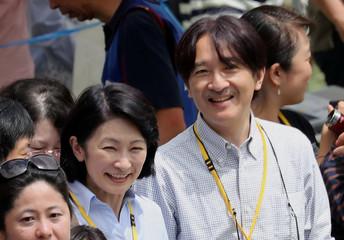 Prince Akishino and Princess Kiko watch as their son Prince Hisahito participates in a sports meeting