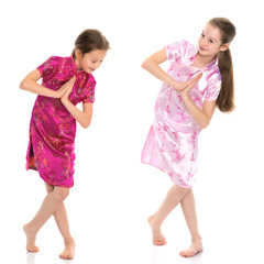 Girls are sisters in Chinese national dresses.