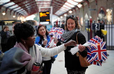 People arrive at the train station ahead of the wedding of Britain's Prince Harry to Meghan Markle, in Windsor
