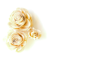 three artificial roses on a white background