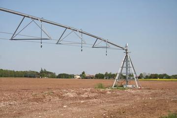 Industrial irrigation system on a field. Agricultural landscape in springtime