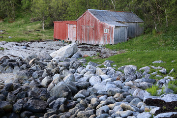 Old boat houses and pebbles