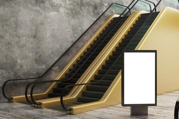 Golden escalator with empty banner