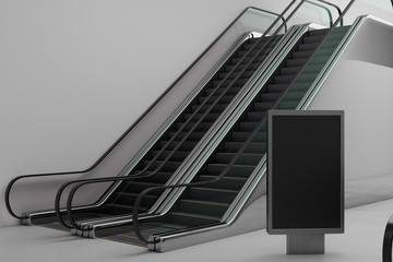 Silver escalator with empty poster