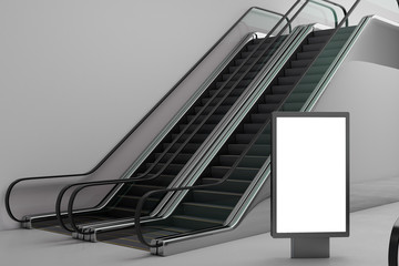 Silver escalator with empty banner