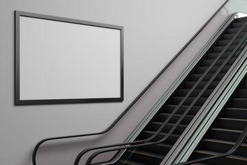 Silver escalator with empty billboard