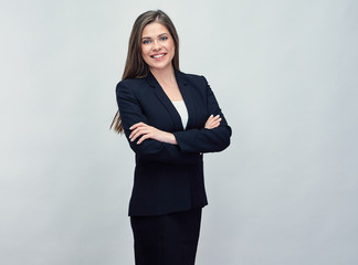smiling business woman wearing black suit standing with crossed