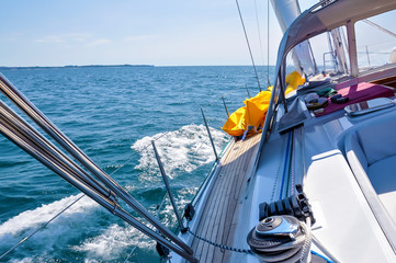 View from luxurious sailboat sailing through the ocean.