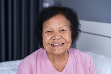 close up of happy smiling senior woman face