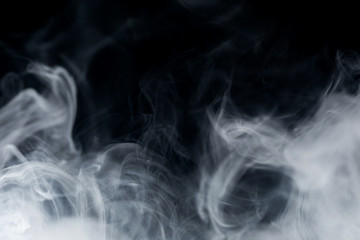 Make smoke from incense.  Black background