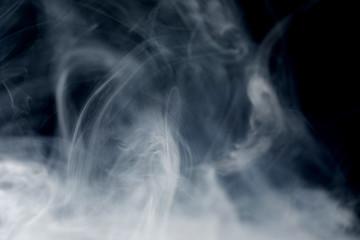 Make smoke from incense.  Black background