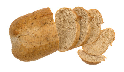 Top view of a small whole wheat bread loaf with slices isolated on a white background.