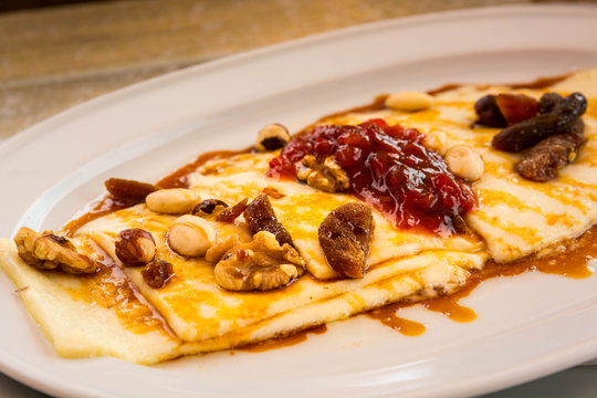Grilled cheese with honey and nuts, typical dessert of the Canary Islands, Spain