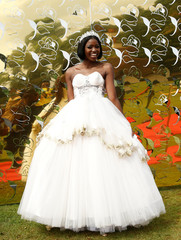A guest dressed in a wedding gown poses for a photograph as she arrives to watch a TV broadcast of Britain's Prince Harry and Meghan Markle's royal wedding at the Windsor golf and country club in Nairobi