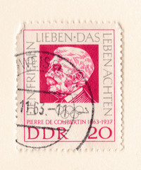 An old red east german stamp with an image of Baron Pierre de Coubertin founder of the International Olympic Committee