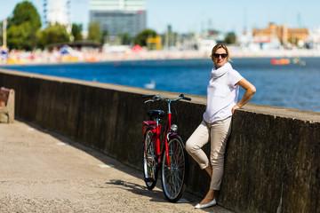 Urban biking -  woman and bike in city