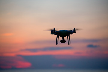 The drone in sunset sky.