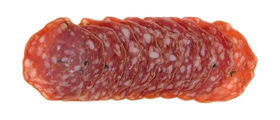 Top view of slices of uncured soppressata dry salami in a row isolated on a white background.