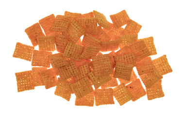Top view of a portion of cheddar cheese crispy rice crackers on a white background.