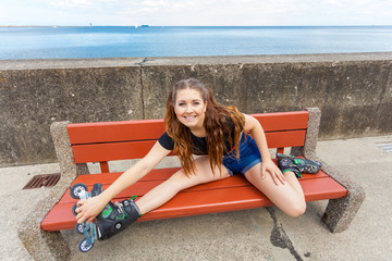 Smiling girl with roller skates outdoor
