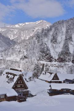 Mountains with Snowy Gassho-zukuri Houses of Shirakawa-gou, Japan.