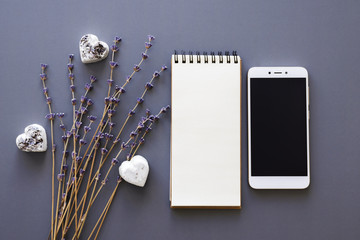 blank noteboook, smartphone and lavender
