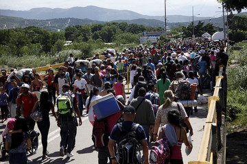 People cross the Colombian-Venezuelan border over the Simon Bolivar international bridge in San Antonio del Tachira