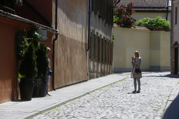 Women take a picture in the Old Town of Vilnius