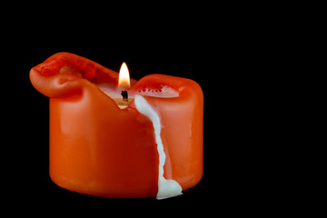 Melted Candle on a Black Background