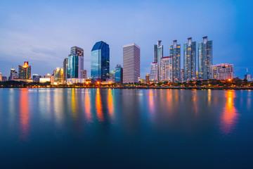 Bangkok city downtown at twilight with reflection of skyline, Benjakiti Park, Bangkok,Thailand