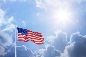 Fototapete - American Flag Against Blue Sky