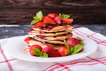 American pancakes with jam and fresh strawberries
