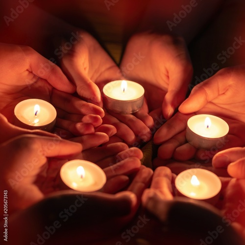 prayer with candles in hands