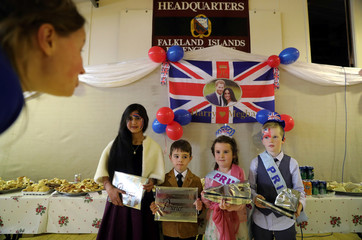 Winners and runner-ups in the Best-Dressed Prince and Princess competition pose for a photo during an event to celebrate the royal wedding between Britain's Prince Harry and Meghan Markle at the Falkland Islands Defence Force headquarters in Port Stanley
