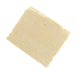 Top view of a block of Feta cheese on a white background.