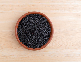 Black rice in a small bowl on a table