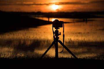 Silhouette Camera is recording the image of the sunset.