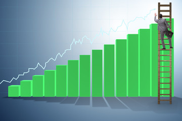 Businessman climbing towards growth in statistics