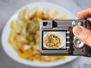 food photography concept photo. man taking food photography