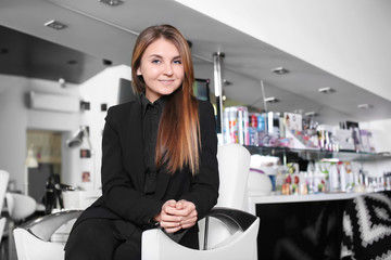 Young female hairdresser in beauty salon