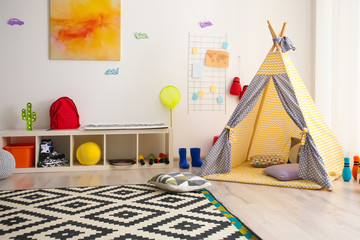 Modern room interior with play tent for child
