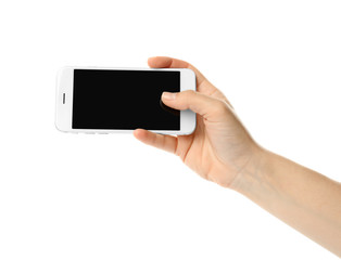 Woman with mobile phone taking selfie on white background