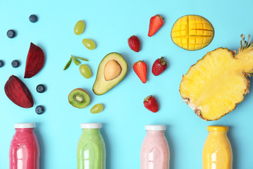 Flat lay composition with healthy detox smoothies and ingredients on color background