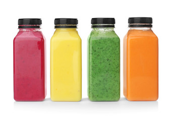 Bottles with delicious detox smoothies on white background